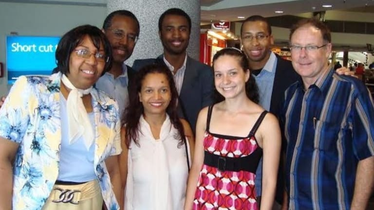 Candy Carson, Ben Carson, and sons Murray and BJ with friends, Greg Whyte, daughter, Coreena, and wife Medgee at Perth Airport in 2010.