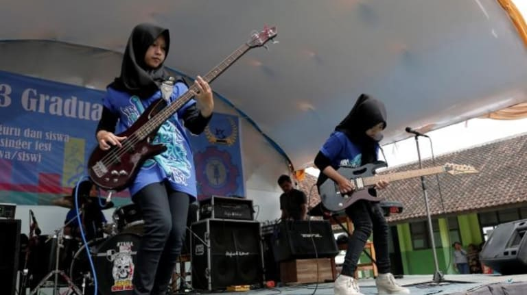 Widi Rahmawati (L) and Firdda Kurnia, members of the metal band Voice of Baceprot, perform during a school's farewell event in Garut, Indonesia, May 15, 2017.