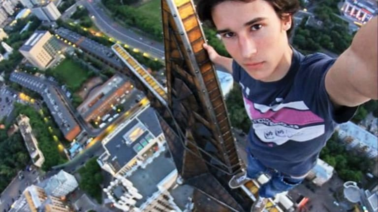 Extreme selfie poseur, Kirill Oreshkin (still alive). The Russian government has launched a campaign against such dangerous photographs, which has led to the deaths of others.