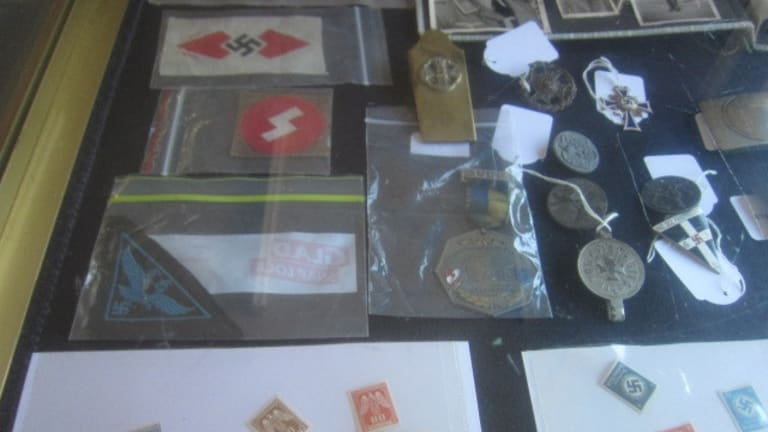 Reflecting ideology: Items of Nazi memorabilia sold at an ACT auction house on Sunday.