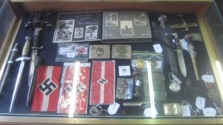 Symbols of hate: Part of a collection of Nazi memorabilia which was auctioned off in the ACT over the past two months.