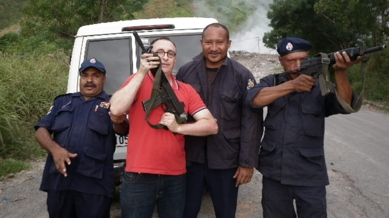 Nathan Sykes with unidentified men in Papua New Guinea in about 2012.