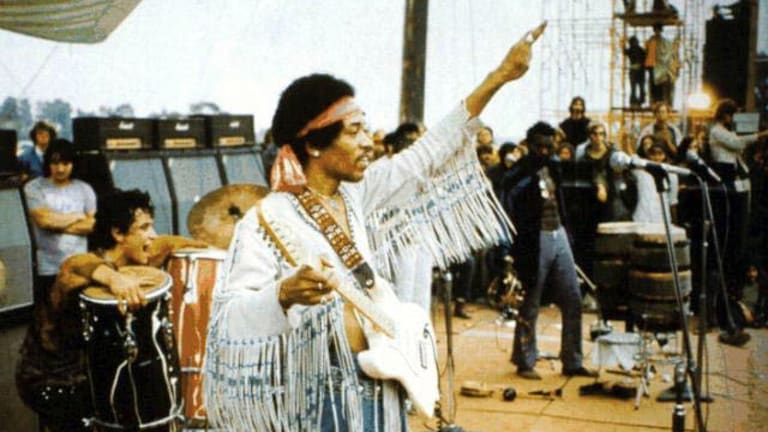 Hendrix at Woodstock in 1969, during the period the unreleased songs were recorded.