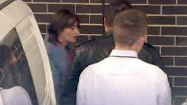 Harriet Wran is led to Liverpool Local Court.
