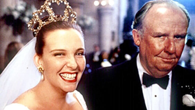 Toni Collette and Bill Hunter in <i>Muriel's Wedding</i>. Gary Sweet will play Bill Hunter's role of Muriel's dad in <i>Muriel's Wedding the Musical</i>.