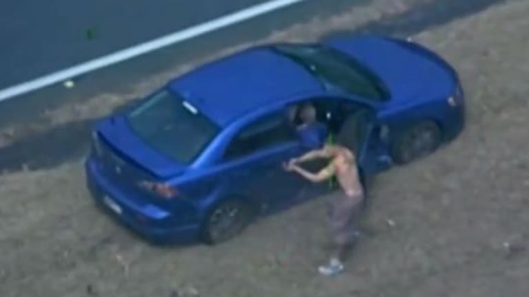Police release footage of the moment a 154 km car chase ends with the gunmen sprinting towards oncoming traffic with one man firing at a passing car.