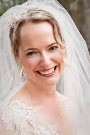 Caitlin Fitzsimmons estimates her wedding cost under $15,000.
