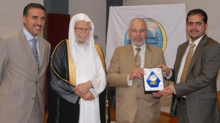 Hafez Kassem (second from right) resigned as AFIC president but now claims it was only temporary.