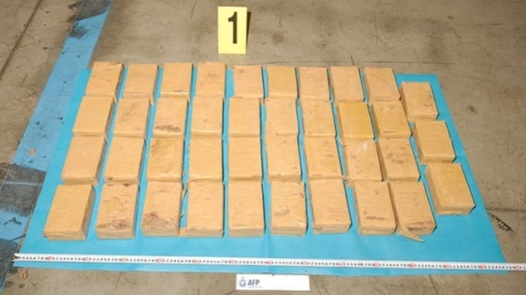 Officers swapped the 78 blocks of heroin contained in the bases of the altars for an innocuous powder and planted listening and tracking devices.