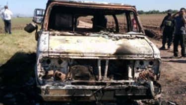 The burnt-out van found in the search for the missing Australians.