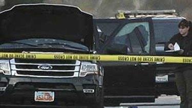 The SUV driven by shooters Tashfeen Malik, 27, and her husband, Syed Rizwan Farook, 28 in San Bernardino is examined by a policeman.