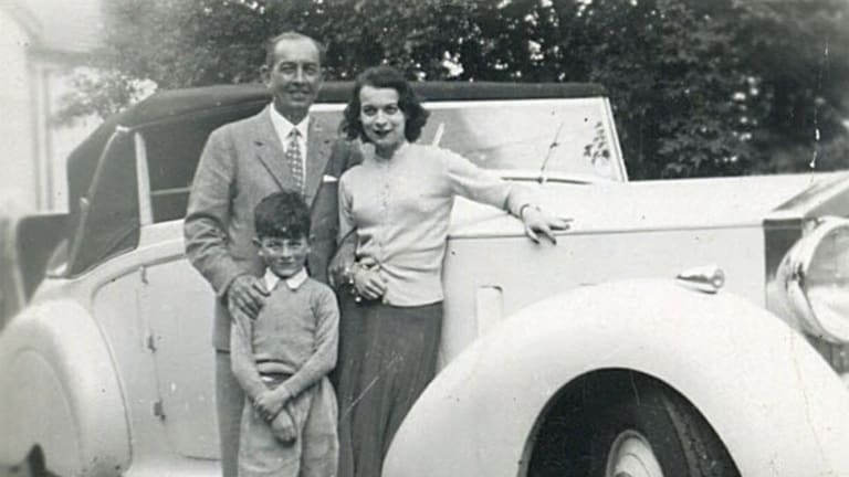 Spy, lover, scoundrel: Walter Dicketts with his fourth wife Judit, son Robert and a Rolls Royce.