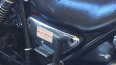 A Hells Angels sticker attached to one of the motorbikes.
