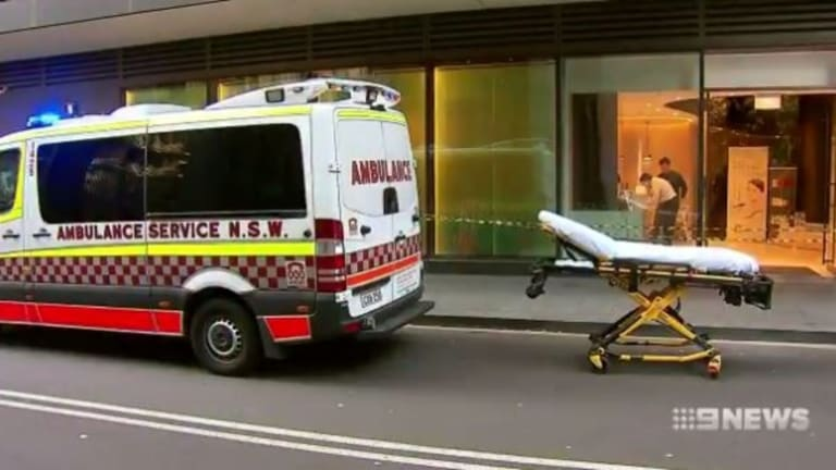 Paramedics at the scene of the Medi Beauty clinic in Chippendale on Wednesday afternoon.