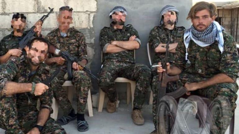 Reece Harding with Kurdish fighters.