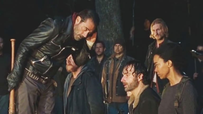 Negan (Jeffrey Dean Morgan) ponders which of the 11 he will dispatch with Lucille in the season six finale of The Walking Dead.