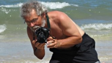 Environmental photojournalist Gary Braasch photographing sea turtles in Mexico.