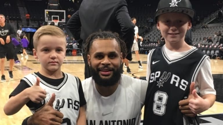 San Antonio Spurs NBA player Patty Mills greeting Luke Allen after winning a competition for his Game Day! book