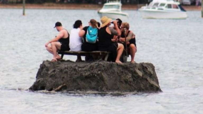 "Kiwis drinking in ""international waters"" on New Year's Eve at Tairua."