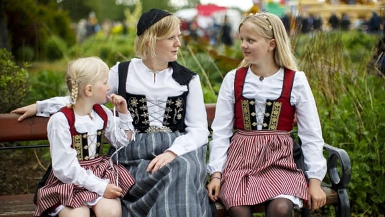 A woman and two girls are seen in traditional dress as Icelanders celebrate the Icelandic National Day in Reykjavik, Iceland on June 17, 2016.