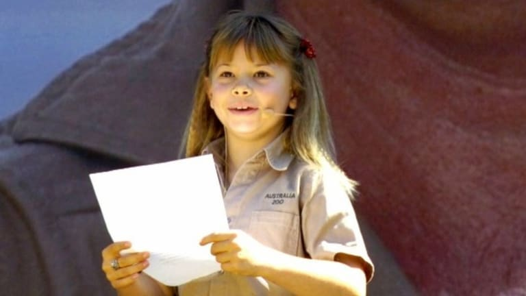 Bindi Irwin, daughter of Australian environmentalist and television personality Steve Irwin, reads out a tribute at a memorial service for her father at Australia Zoo in 2006.