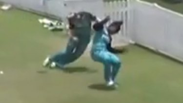 Dottin and Harris collide at full pace as they try to prevent a boundary.