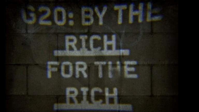 A slogan sent out by the guerilla projector at the 2014 G20 Summit in Brisbane.