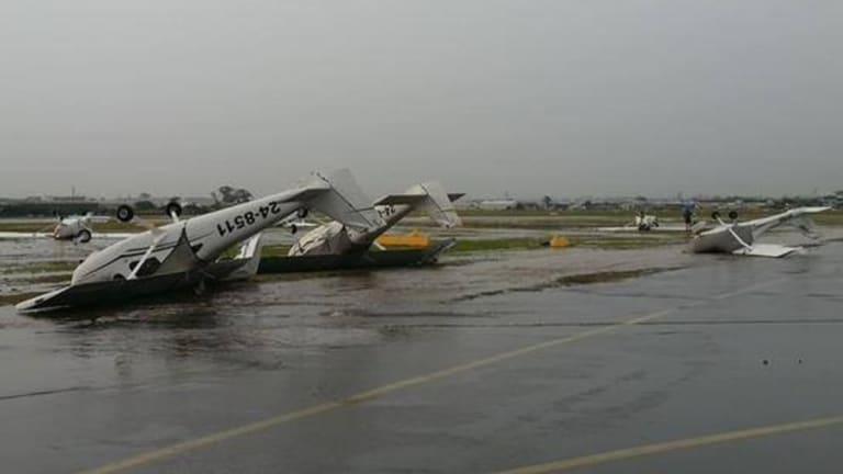 Violent storm lashes Brisbane on Thursday, November 27. Plane overturned at Archerfield.