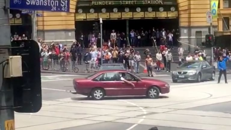 The Holden Commodore was seen doing burnouts outside Flinders St station in the lead-up to the tragedy.