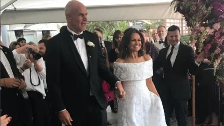 Today's Lisa Wilkinson and husband Peter FitzSimons recently said 'I do' ...  again.
