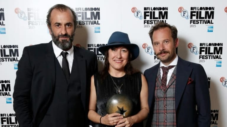 Panos Koronis, Athina Rachel Tsangari and Giorgos Pyrpassopoulos after <i>Chevalier</i> was named best film at the 2015 BFI London Film Festival Awards.