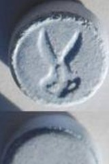 """An """"ecstasy"""" pill, with scissor stamp, similar to the one used by the four people hospitalised ."""