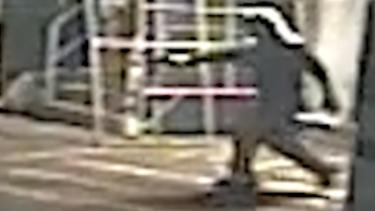 A gunman fires at Michael Rooke.
