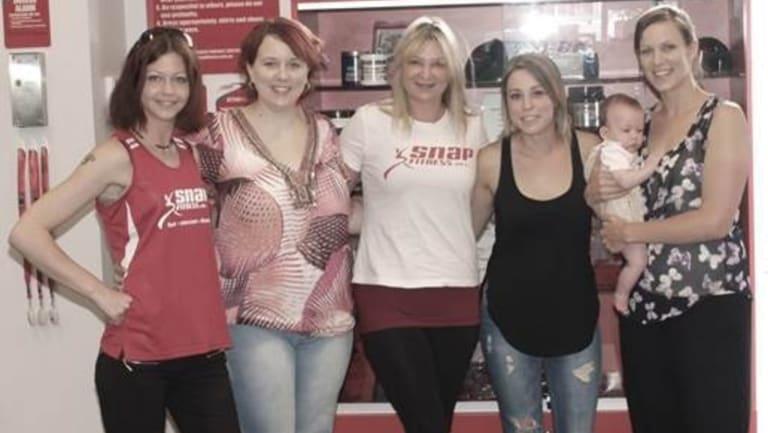 Sky-diving mums: Maya Myers, Rachel Mallia, Heidi Porotschnig, Lauren Jackson and Kate Deakin, with baby Rachel.