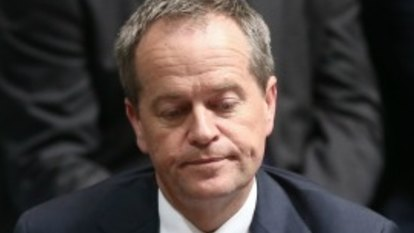 Bill Shorten reports himself to police for using mobile phone while driving