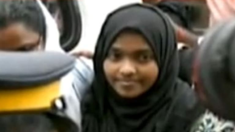Hadiya who converted from Hinduism to Islam and married a Muslim man, arrives at the Kerala airport on Monday.