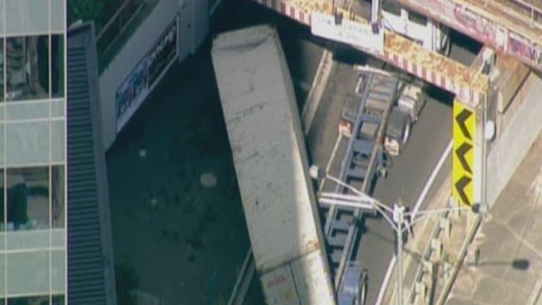 A truck has hit an overpass in Footscray.