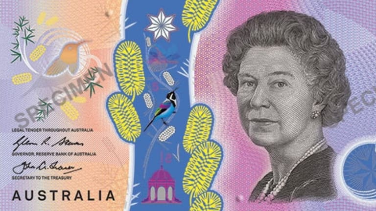 The new $5 bill will enter service in September.