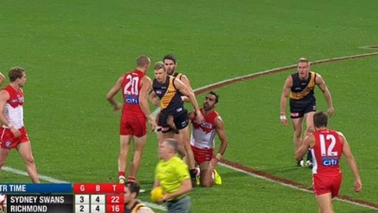 Adam Goodes and Tiger Taylor Hunt clash at quarter-time.
