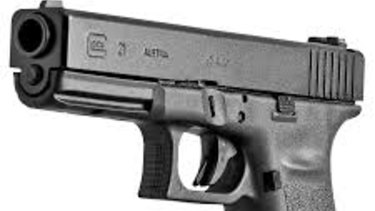 A Glock handgun, similar to those that many members of the club own