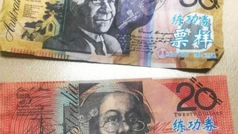 Act Policing Find Counterfeit Cash With Chinese Characters In Canberra