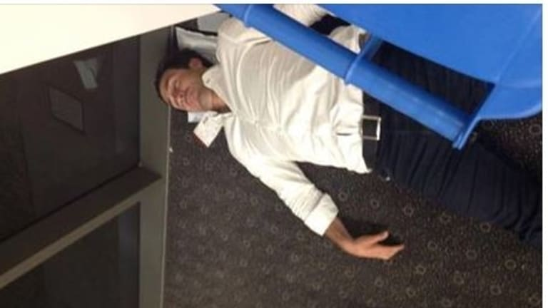 Bad form: The Facebook post of Andrew Johns asleep in Toowoomba Airport.