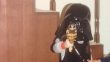 Iconic costume piece: Chris in the Darth Vader helmet.