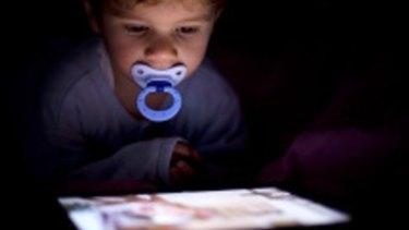 A toddler using an iPad.