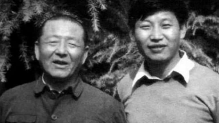 Xi Jinping and his father Xi Zhongxun, a war hero who later suffered during Mao's Cultural Revolution.