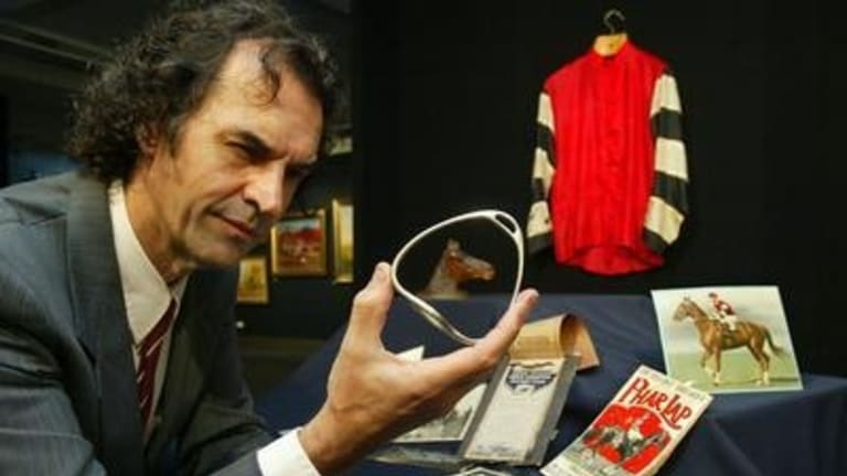 Memorabilia expert Tom Thompson with Phar Lap objects.