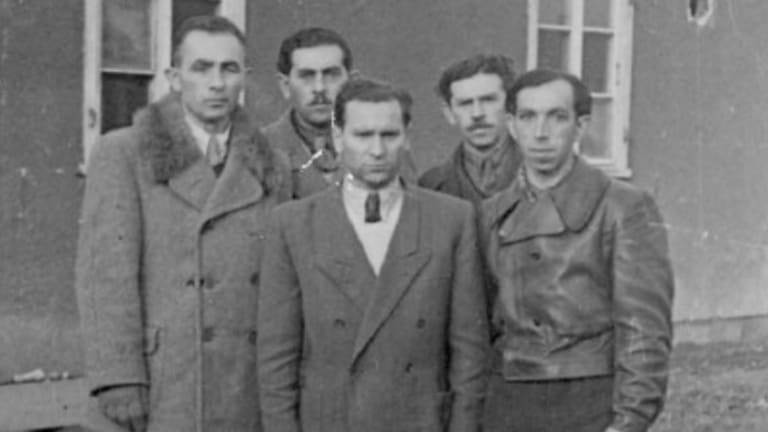 Josh Frydenberg's great-uncle Hersz, centre, with fellow Auschwitz survivors.