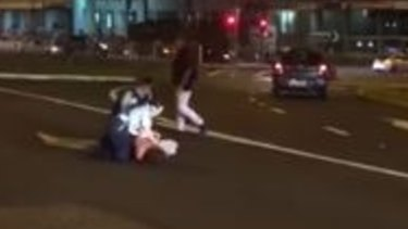 Police arrest a male in the middle of the Pacific Highway at Charlestown following an out-of-control party.