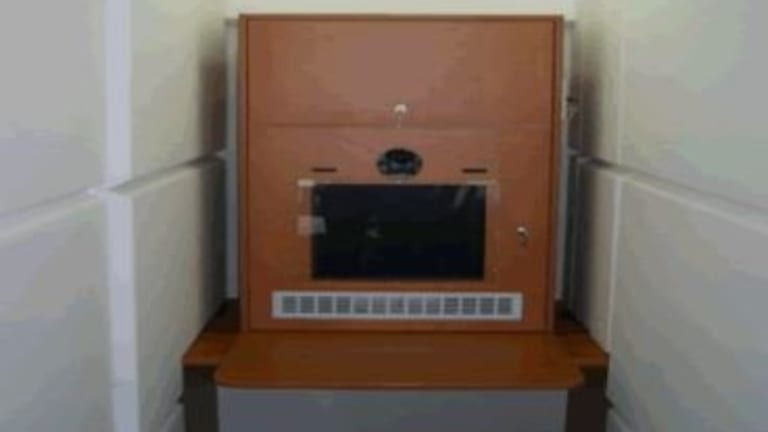 A typical audio-visual link booth in a NSW prison.
