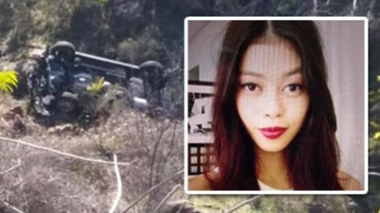 Despite leg and abdominal injuries from the crash, 19-year-old Kathleen Bautista climbed at least 100 metres uphill after escaping her upturned car in the Cotter reserve area, west of Canberra.